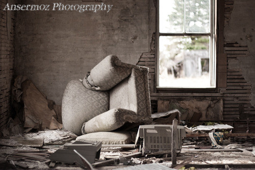 Abandoned house interior with furniture and window
