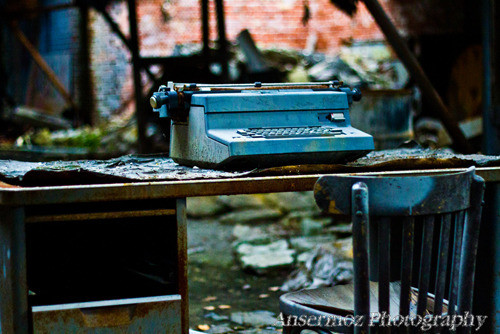 Typewriter on desk in abandoned places