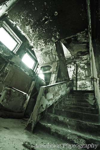 Stair case art in delapidated building