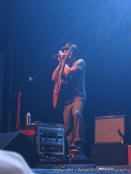 John Butler in Montreal playing harmonica