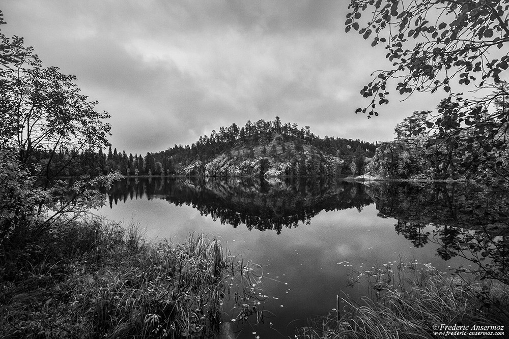 Aventojoki river, Ristikallio, black and white water reflection