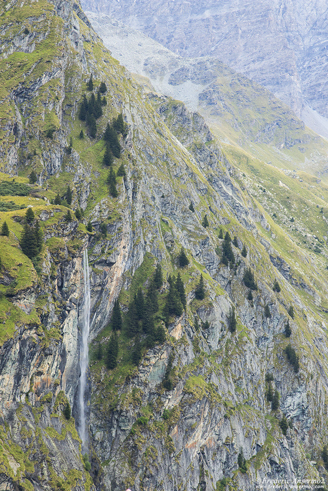 Waterfall along the cliffs of Val de Bagnes, Valais, Switzerland