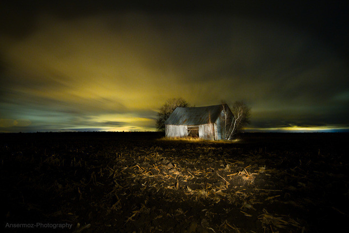 Lightpainting of barn in field in Quebec by Frederic Ansermoz