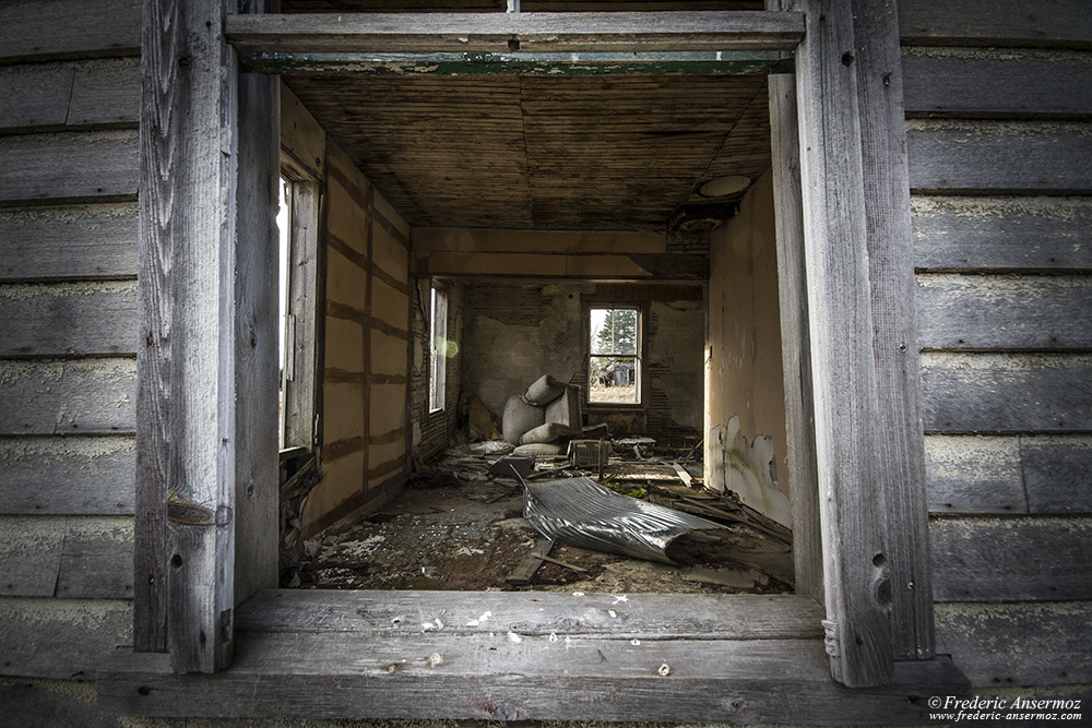 Abandoned house interior view through a window