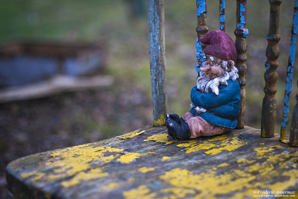 Garden gnome sleeping on an old chair
