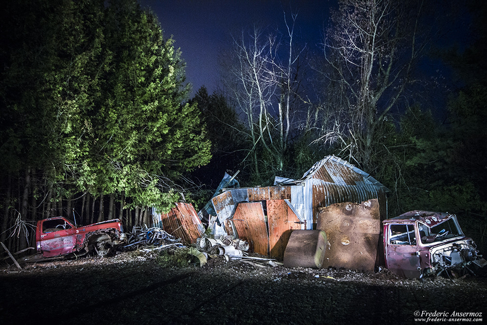 Lightpainting on rusty shed and abandoned car graveyard