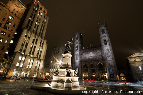 Basilica Notre Dame of Montreal by night at Place d'Armes