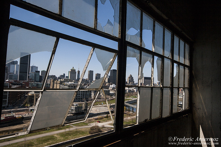 Montreal skyline through broken windows